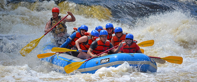 A group of guests rafting with Thornton's Raft Resort and Campgrounds